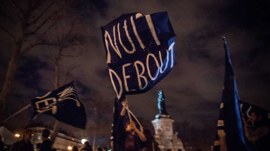 """Benjamin Girette / IP3 : Paris France April 6th, 2016 : People join the """"Nuit Debout"""" or """"Standing night"""" movement at the Place de la Republique - A few hundred people rallied northern Paris in the wake of the nationwide demonstration against the labor reform law which took place on March 31 and started to occupy the Place. A special flag written Nuit debout or Standing night is carried at night on the place. FRANCE ONLY (MaxPPP TagID: maxnewsfrthree725610.jpg) [Photo via MaxPPP]"""